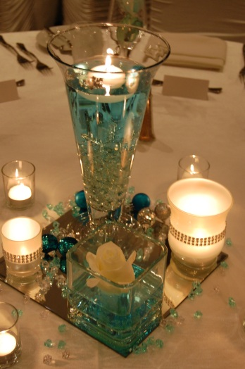 Snowflakes floating in Tiffany blue water